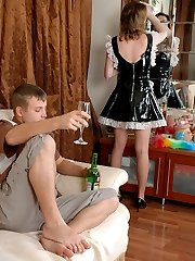 French maid flashing upskirt before sliding nyloned feet into guy�s mouth