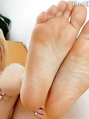 Elsa Jean wants her personal assistant to fix some things around her house. She knows what turns him on and gets her feet right around his face. He can't hold back sucking on her toes. She strokes his hard cock with her feet and fucks her pretty pussy until he explodes all over her feet.