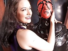 Two merciless mistresses keep their spandex victim in bondage and train him