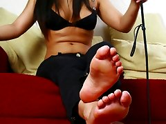 Cruel asian mistress trains her slave as she is watching the TV