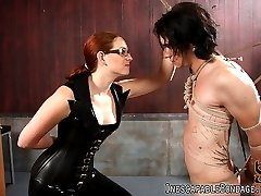 Miss Nikki Nefarious is a highly skilled rope bondage artist, not to mention a sexy Domme. Previously an off-camera rope bondage specialist, Miss Nikki ties up Deviant Kade in her first time on film. Using her intricate rope bondage skills, Miss Nikki Nefarious ties Kade to a bondage rack and starts to torture him.