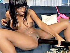 Ebony babe fucking huge toys and a baseball bat