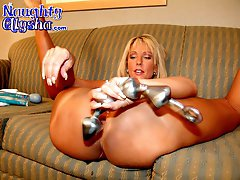 Slutty blonde uses toys in her asshole, then gapes it with a speculum