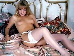 Young and petite blonde undressing and revealing unshaved twat