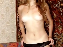 Horny blonde babe pulls down her panties to show off her cute untrimmed bush and rub her clit
