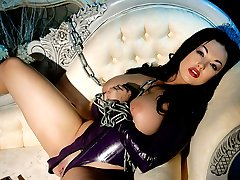 stacked fetish vamp spread in chains and rubber