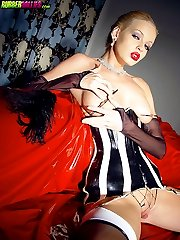 blonde in latex corset and heels pinches nipples
