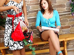 Strap-on armed chick in shiny stockings luring a girl into lesbo making out