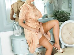 Dolly likes to dress in vintage and retro style. A prim tea dress but absolutely panty-less!