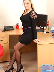 Naughty secretary does a sexy strip in her office.
