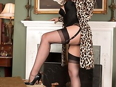 Sophie posing in her satin basque, black ff nylons all topped with a sexy leopard print coat!