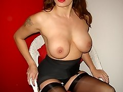 Goregeous Milf Nylon Jane teases her big juicy tits in marvelous nylons, undergarments and high high-heeled slippers