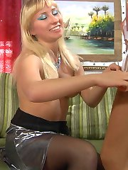 Strap-on armed lezzie in dark stockings shows a cutie some fucking tricks