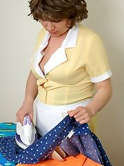 Mature French maid in silky pantyhose ironing before gagging on bulky meat