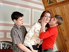 Brunette in control top hose giving blowjob and getting fucked by two guys