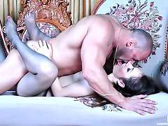 Naughty babe teases a stud with her sexy nyloned feet and gets them creamed