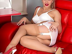 Beth, the waitress has nyloned shapely legs served with high heels and plenty of heaving breast!