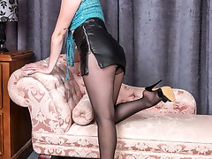 We join Kiana on the chaise in a very revealing crocheted skimpy top, tiny leather mini skirt and fancy top black pantyhose.