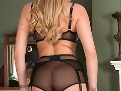 Danielle loves to tease in her grey deep top sheer nylons as she strips and poses playing in her stylish retro lingerie!