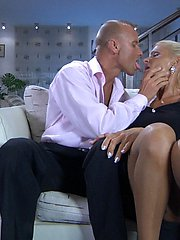Slim blonde mommy screwing topless with a hot tattooed stud in the bedroom