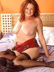 Cheeky old redhead slut shows you her pussy