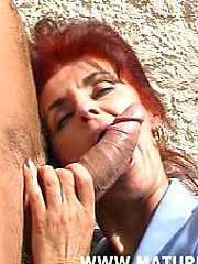 This red mature slut loves a hard cock