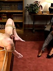Nika Noire is fed up with her husband Vern never giving her the sexual pleasure she deserves. She takes him to an eccentric psychologist who specializes in tantric sex. His ways may be unconventional however, they are sure to give Nika the orgasms she craves. Vern is tied up and humiliated in front of the doctor. He's flogged and placed in a tight chastity device for having such an inadequate cock. Nika humiliates him for having such a small penis and clamps his nipples. He's rammed deep in his ass with a strap-on from his wife while she makes out with the doctor. Nika then commands him to get the doctors cock hard with his mouth so she can fuck the doctor in front of him and finally get the sexual pleasure she deserves! To really humiliate her husband Nika asks the doctor to cum on her beautiful pussy and makes her husband clean it all up!