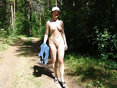 Nudist posing sleazy for her lover in public