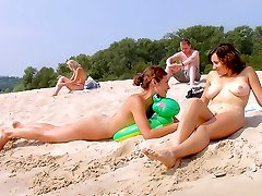 Steaming hot nubile nudists naked at a public beach