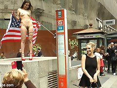 Juliette March is an embarrassment to the USA. This slutty loser tourist with her pathetic selfie stick is lost in Madrid! Mona Wales doesn't even want to be seen with her. Luckily no one is better at humiliating Juliette March more than herself. She gets fully nude in a crowded downtown area and drapes an American flag around herself. After shaming herself in front of everyone, she is hungry for Euro COCK! At a crowded bar this anal slut gets double filled and fucked hard in rope bondage. Everyone there gets a piece of this american pie!