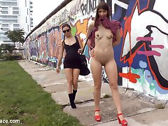 Juliette March has the impossible task of training her shiny new slut, Suzan Ayn.  Suzan is in dire need of strict training on how to behave in public. She does not moan, she does not smile, she can barley walk in heels.  At a loss of what to do Juliette drags Suzan along the ground, exposes her ass, clamps her little pink nipples and then leaves her naked in front of a crowd of tourists who laugh take selfies of with Suzan's pathetic face. After all that punishment Suzan continues to be disobedient.  Frustrated, Juliette stands over her defiant whore and relieves herself into Suzan's mouth.  Finally, Juliette is convinced that her whore has been sufficiently disciplined and decides to rewards Suzan by taking her to a bar to get her little pink hole pounded by anyone who can get a hard-on.  Two hot goth girls begin stripping, kissing and fucking at the site of Suzan's open cunt.  Old men and jerk off and face fuck Suzan as Juliette attempts to shove her fist inside Suzan's dirty little cunt. Maybe it was the corporal punishment, maybe it was the humiliation or maybe Suzan just needed some deep dicking but by the end of the day Suzan is moaning and begging for all the cum she can get.