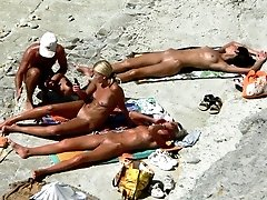 Chicks caught changing and sunbathing at the seaside