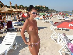 Hot chicks flaunt breasts at the beach