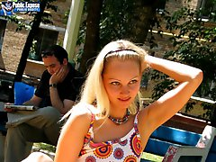 Blonde flasher teases a guy on the bench