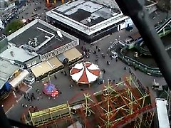 Very cute barely legal blondie sucking cock in public on a ferris wheel