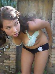 Big-tittied babe posing topless in public