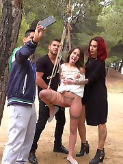 Summer has come to Barcelona, bringing with it a fresh batch of european sluts who want nothing more than to be publicly fucked and humiliated. The first girl to spread her legs for this season of Public Disgrace is Alexa Nasha. Part one:Perky Teen Alexa Nasha, in a white summer dress, is bound with rope from a tree in a public park. Couples sit at picnic tables enjoying the gorgeous summer weather. Slowly, people begin to notice that something interesting is going on as Steve Holmes, Silvia Rubi and Juan Lucho descend upon their bound teen beauty. Alexa squeals with excitement as the group of three tormentors begin lifting up Alexa's skirt to reveal her dripping wet tight cunt. Several folks move away from the exposed girl in pure disgust while others gather around Alexa in amazement. With her hands tied Alexa is unable to resist as she gets passed between the three. The feeling of two uncut cocks sliding in and out of her completely exposed public holes causes Alexa to moan with pleasure. This is only the beginning. Part Two:Alexa Nasha puts her face on the beer soaked floor of a crowded Barcelona bar. She squeezes her eyes shut as everyone in the bar looks at her swollen teen cunt. She winces at the idea that everyone can see how excited she is. Her asshole clenches as someone reaches down and slides a finger from her throbbing clit to her dripping hole. Pushing her hips back, Alexa's body begs to get fucked hard and fast. A man yanks her head off the ground by her hair and yells something in a language she doesn't understand. Opening her eyes to a throbbing cock in front of her mouth she knows exactly what the man needs her to do. With her mouth gaping one man fucks her throat while another penetrates her tight cunt. The crowd chants as she submits to her rightful place as the cum spittoon for the bar.
