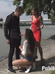 Tina Kay buys two Hungarian whores, Lia and Laurita, for Steve Holmes do do with what he pleases.  Steve and Tina lead them both by leash and collar through a sketchy neighborhood in the hot weather to then get face fucked on their knees in the gravel down by the river. Later at a bar, these two sluts have the patrons speechless as they work up a sweat getting fucked every which way, and get hot loads in the hot sticky weather.