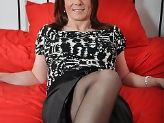One seriously cute TGirl posing in her short microskirt and nylon tights.
