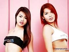 Two Young Asian Shemales Getting Naked in Bed