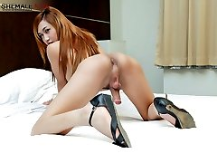 Hot redheaded ladyboy explodes with huge spunk