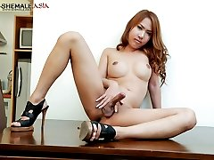 Ladyboy wanks her rock solid pork rocket