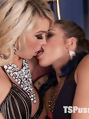 Kiki Sweet is snooping around in a room at a boring dinner party. Aubrey Kate walks in on Kiki rummaging through her things. These two rich brats are tired of playing nice at dinner parties so they decide to rebel and fuck all night rather than be polite to guests. While they are getting sensual kissing in, Kiki feels Aubrey's hard  TS cock pressing against her and immediately wants to suck it. Kiki breaks out the strap on and fucks Aubrey in the ass. These two scissor fuck until Kiki cums hard