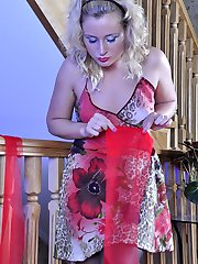 Dazzling curly-head posing sexy in all sorts of luscious colored stockings