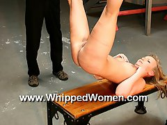 Hanged pussy up for whipping
