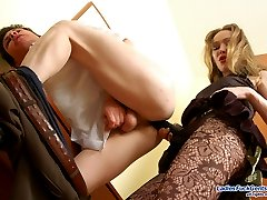 Cutie in patterned hose is about to give guy new strap-on fucking sensation