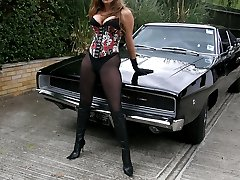 Strapon Jane posing outdoors infront of sexy mustang car