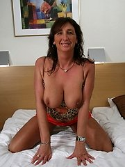 Horny mature slut toying with her pussy
