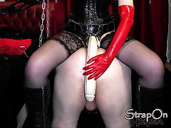 Strapon Helga dominates this sissy slut in her dungeon