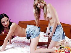 Hot teen girls use a squirting strap-on for some naughty fun
